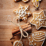 Christmas gingerbread cookies and fir tree on fabric background Royalty Free Stock Photography