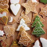 Christmas gingerbread cookies and fir tree on fabric background Royalty Free Stock Photo