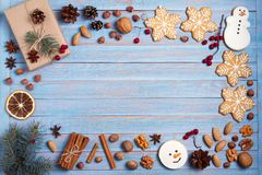 Christmas gingerbread cookies on blue wooden background with copy space for text. Holiday, celebration, festive and cooking concep royalty free stock photo