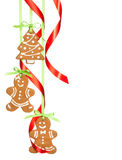 Christmas Gingerbread cookies. Gingerbread cookies hanging with red and green ribbon isolated on white stock photos