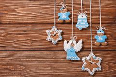 Christmas gingerbread cookies hanging on a wooden Stock Photo