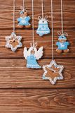 Christmas gingerbread cookies hanging on a wooden Royalty Free Stock Photo