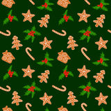 Christmas gingerbread cookies and holly seamless Stock Images