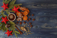 Christmas gingerbread cookies with icing, cup of tea, fir-tree b. Ranch on blue wooden background. Collection for Christmas greeting card. Copy space. Top view stock photos