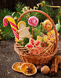 Christmas gingerbread cookies and lollipops in a basket Stock Images