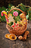 Christmas gingerbread cookies and lollipops in a basket Stock Photos