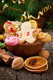Christmas gingerbread cookies and lollipops in bowl Royalty Free Stock Photos