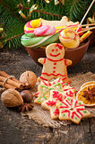 Christmas gingerbread cookies and lollipops in bowl Stock Images