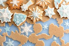 Christmas gingerbread cookies over dough Royalty Free Stock Photos