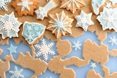 Christmas gingerbread cookies over dough Royalty Free Stock Photos