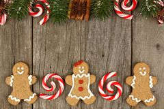 Christmas gingerbread cookies, peppermints and decor on rustic wood Stock Photo