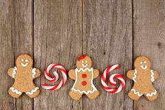 Christmas gingerbread cookies and peppermints on rustic wood Stock Photography