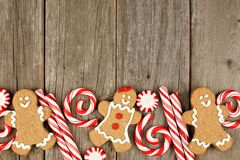 Christmas gingerbread cookies, and peppermints on rustic wood Stock Image
