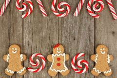 Christmas gingerbread cookies and peppermints on rustic wood Stock Image