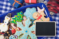 Christmas gingerbread cookies on a plate. And a blackboard Stock Images