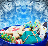 Christmas gingerbread cookies. On a plate on the frosty background Royalty Free Stock Image