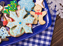 Christmas gingerbread cookies on a plate. On the table Stock Photography
