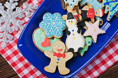 Christmas gingerbread cookies on a plate. On the table Stock Images