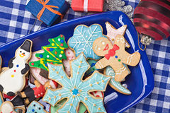 Christmas gingerbread cookies on a plate. On the table Stock Photo