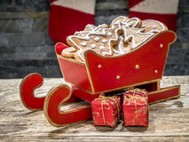 Christmas gingerbread cookies in red mini sleigh Royalty Free Stock Photography