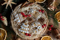 Christmas gingerbread cookies in a round wicker basket, top view. Decorated Christmas gingerbread cookies in a round wicker basket, top view royalty free stock images