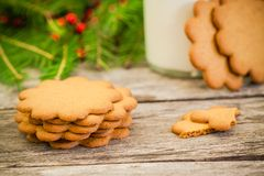 Christmas gingerbread cookies on a rustic wooden background with milk Stock Photo