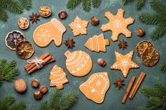 Christmas gingerbread cookies. With spices and  decorations on green stone background. Top view Royalty Free Stock Photos