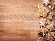 Christmas gingerbread cookies and spices on wooden background Stock Images