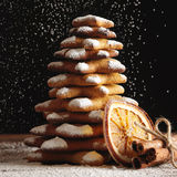 Christmas gingerbread cookies and spices on wooden background Stock Photo