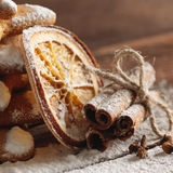 Christmas gingerbread cookies and spices on wooden background Royalty Free Stock Image