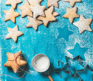 Christmas gingerbread cookies with sugar powder and metal shapes Stock Image