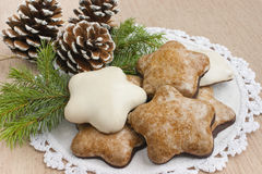 Christmas gingerbread cookies. Christmas gingerbread cookies on a table with Christmas decoration, pine tree twig and pine cones. Christmas food concept royalty free stock photo