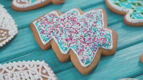 Christmas gingerbread cookies on the table. Good New Year spirit. Christmas gingerbread cookies on the table. Gingerbread in the form of a Christmas tree stock footage