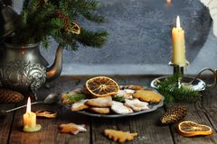 Christmas gingerbread cookies on the table near the window with frost. Christmas gingerbread cookies  near the window with frost Stock Photo