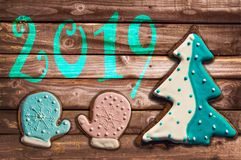 2019, christmas gingerbread cookies on wood greeting card. 2019 christmas gingerbread cookies on wood greeting card stock image