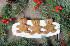 Christmas gingerbread cookies on wooden background Royalty Free Stock Photos