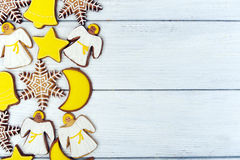 Christmas  gingerbread cookies on wooden background Royalty Free Stock Photo