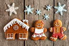 Christmas gingerbread couple and house cookies Stock Images