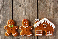 Christmas gingerbread couple and house cookies Stock Photography