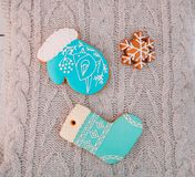 Christmas gingerbread decorated blue mitten boots snowflake. Christmas gingerbread decorated with frosting blue mitten of boots and snowflake stock photo