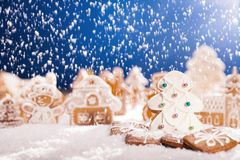 Christmas gingerbread with falling snow Royalty Free Stock Images
