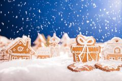 Christmas gingerbread with falling snow Stock Photos