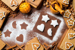 Christmas gingerbread frame surrounded by nuts Royalty Free Stock Photography