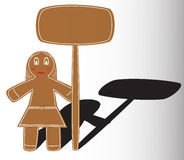Christmas gingerbread girl. With table for business text Stock Photo