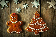 Christmas gingerbread girl and tree cookies Royalty Free Stock Photos