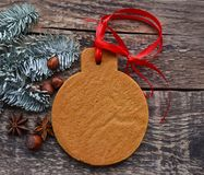 Christmas gingerbread and green spruce branches stock photos