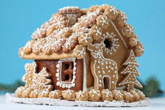 Christmas gingerbread house. On blue background. Shallow dof stock image