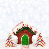 Christmas gingerbread house against a twinkling light background stock photos