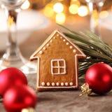 Christmas gingerbread. Gingerbread house on Christmas table stock photo