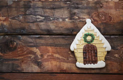 Christmas gingerbread house on wooden background. Royalty Free Stock Images